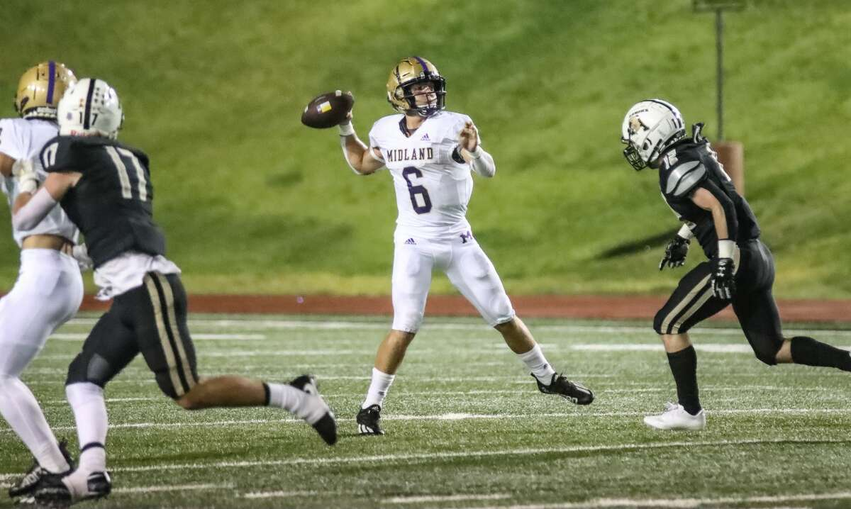Midland High's Landry Walls looks to throw a pass against Amarillo High during Friday's game at Dick Bivens Stadium in Amarillo.