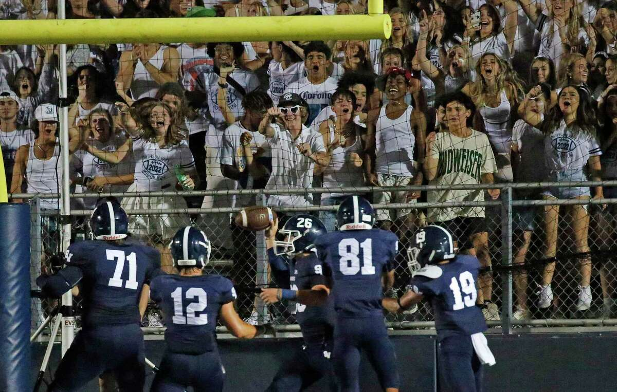 Smithson Valley fans celebrate when Doug Lantz(26) scored their last touchdown in the fourth quarter as Smithson Valley HS defeated Madison 28-0 on Friday, Sept. 3. 2021.