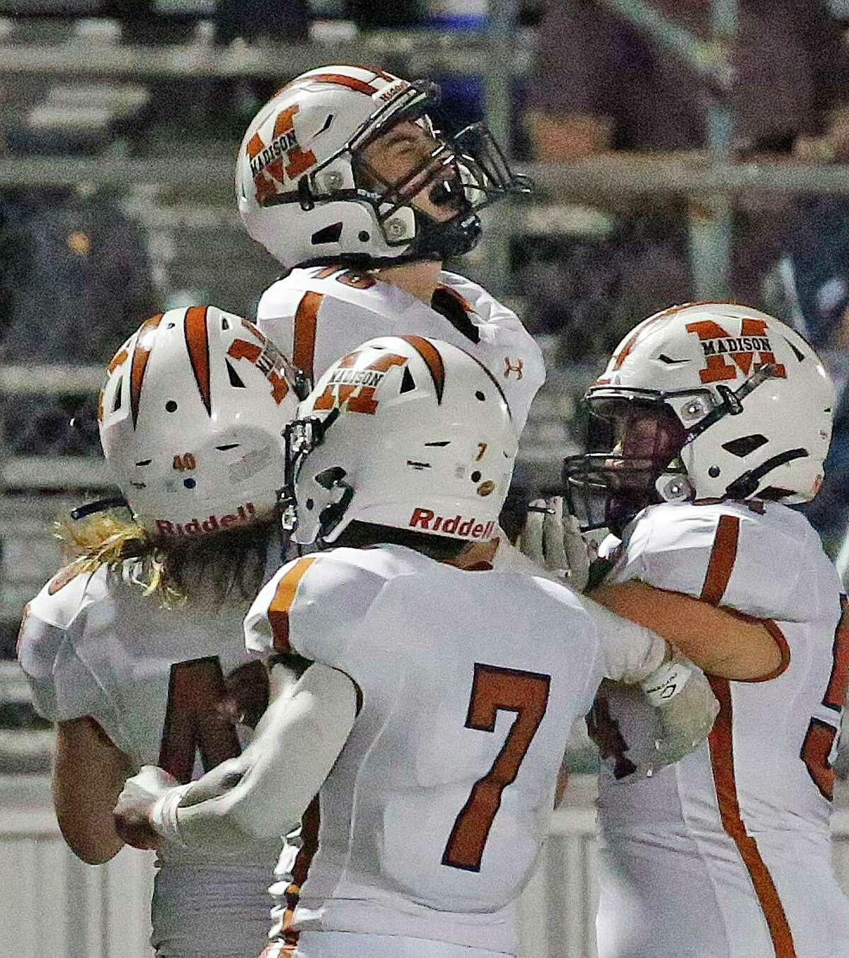 Madison Damian Mendoza(15) is lifted up by teammates after his interception stopped a Smithson Valley drive at Smithson Valley HS on Friday, Sept. 3. 2021.