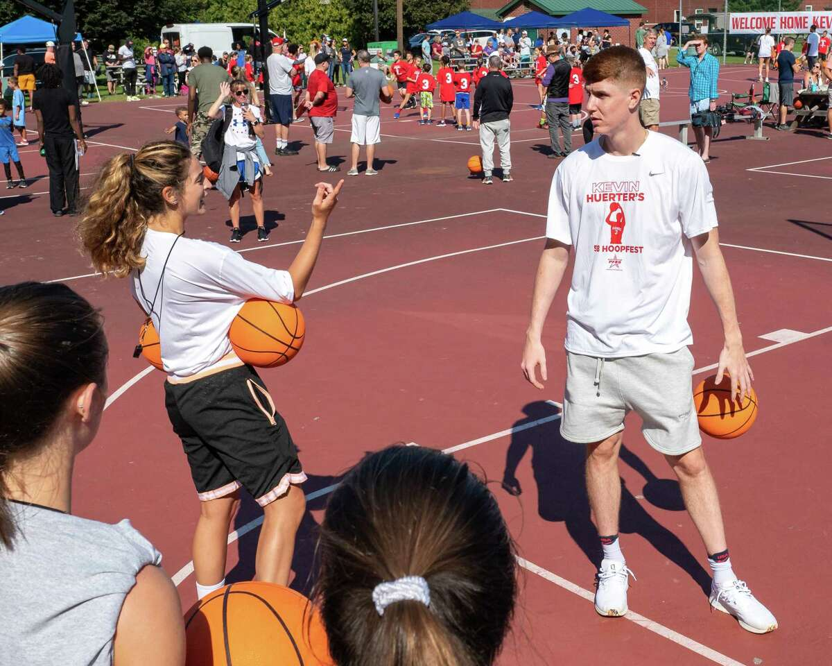 Jackie Bodmer and Kevin Huerter, a former basketball star at Shenendehowa and current Atlanta Hawks player, instruct participants at the Kevin Huerter's 518 Hoopfest at the Clifton Common basketball courts in Clifton Park, NY, on Saturday, Sept. 4, 2021. (Jim Franco/Special to the Times Union)