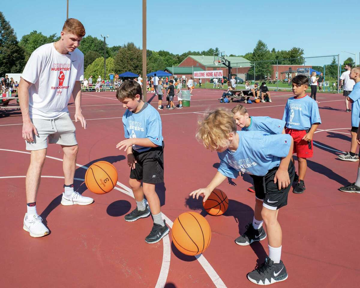 Kevin Huerter, a former hoops star at Shenendehowa and current Atlanta Hawks player, instructs participants at the Kevin Huerter's 518 Hoopfest at the Clifton Common basketball courts in Clifton Park, NY, on Saturday, Sept. 4, 2021. (Jim Franco/Special to the Times Union)
