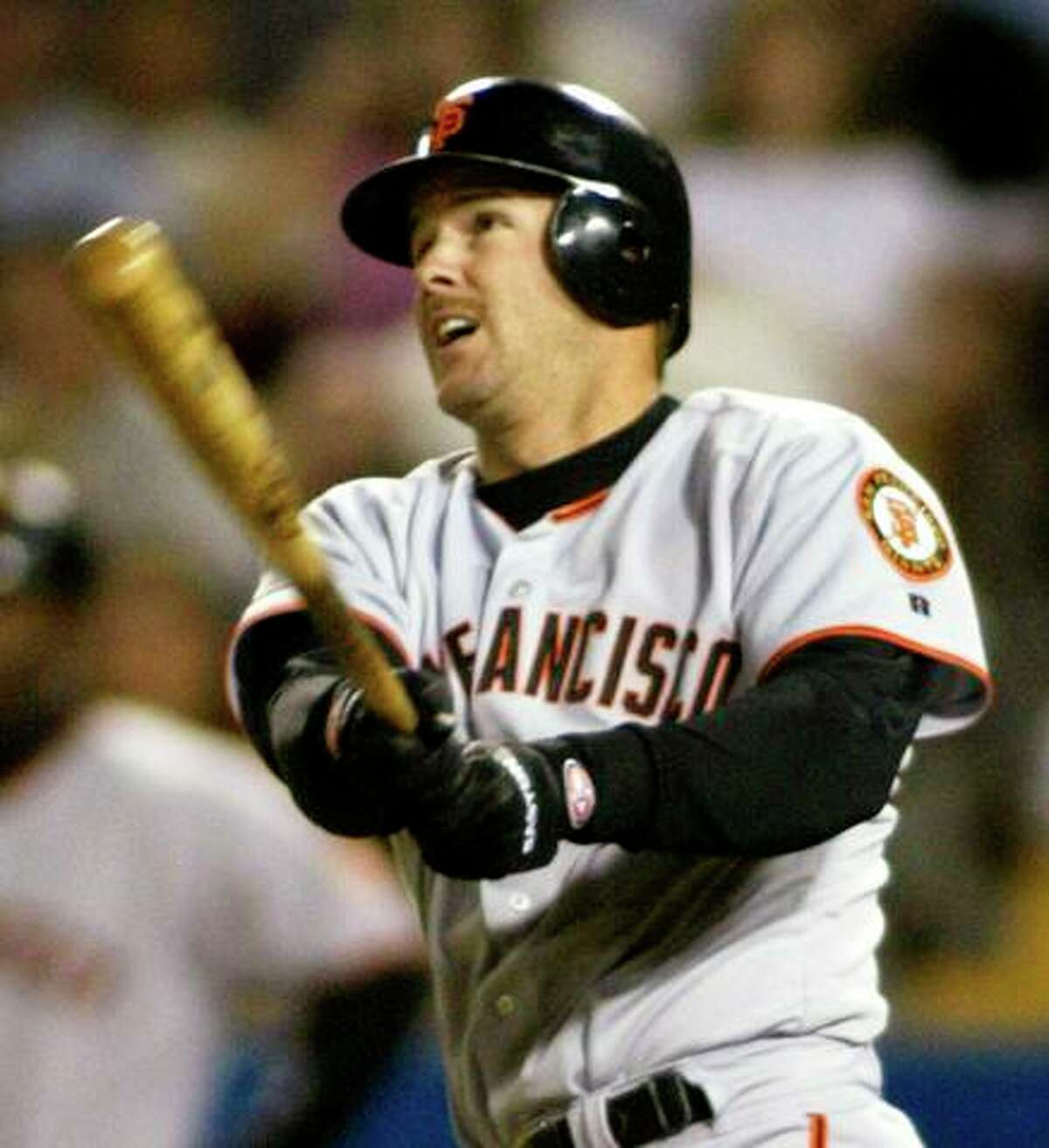 Giants second baseman Jeff Kent watches his solo home run sail into the left-field seats in the first inning of a game against the Los Angeles Dodgers on Sept. 16, 2002.