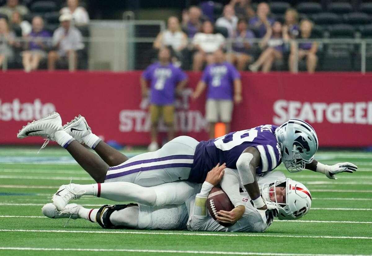Kansas State defensive end Khalid Duke (top) sacks Stanford quarterback Tanner McKee during the second half in Arlington, Texas.