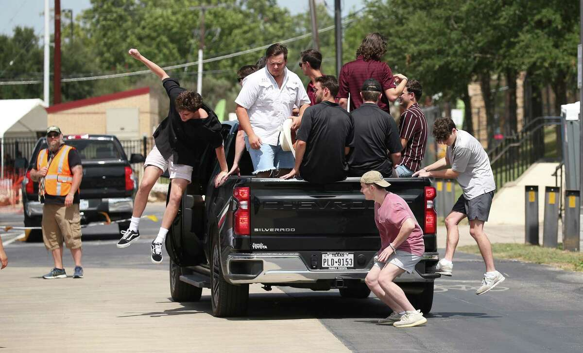 """A truckload of students is delivered to the stadium. The university approved """"all tailgating options"""" this season."""