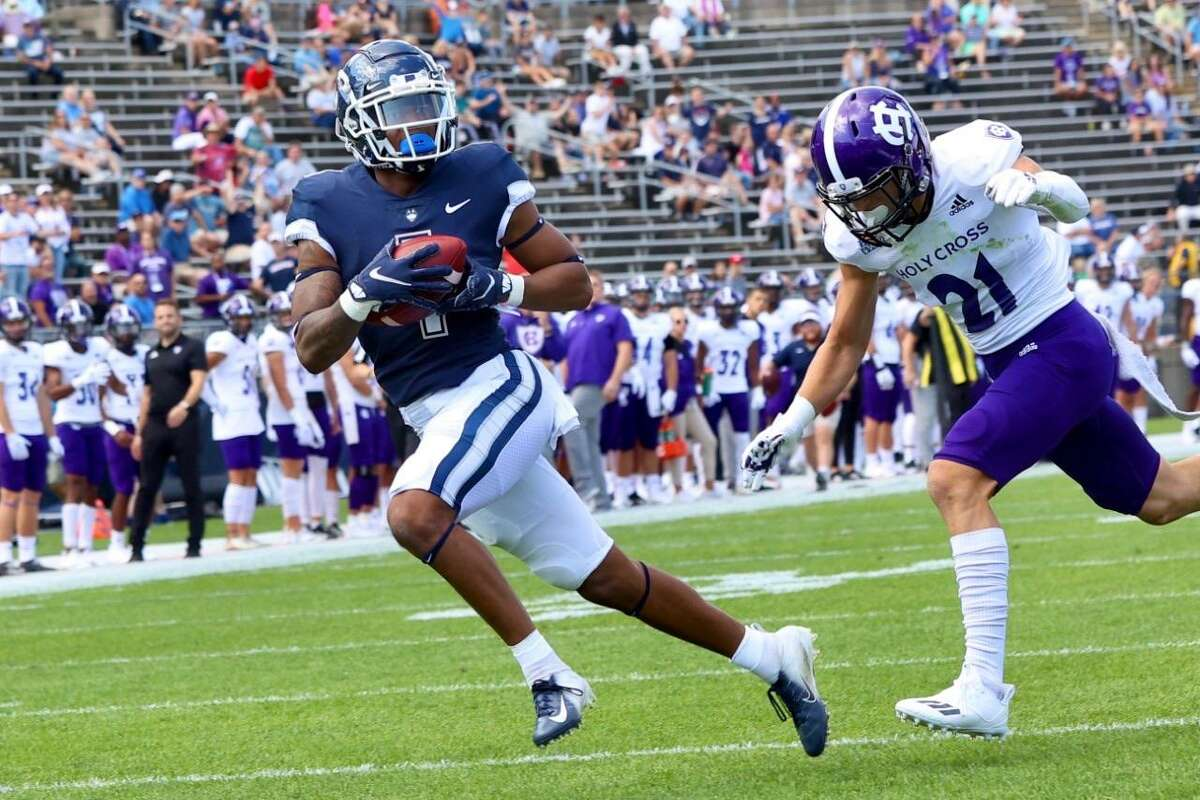 UConn's Keelan Marion, left, had a pair of touchdown receptions against Holy Cross on Saturday.