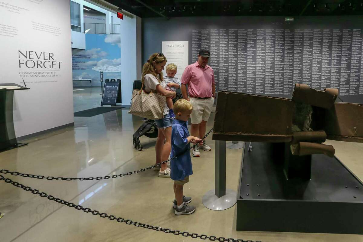 """Kelly and David Leonard and their children Dee and Richard visit the exhibition """"Never Forget: Commemorating the 20th Anniversary of 9/11"""" on September 4, 2021 at the Lone Star Flight Museum in Houston."""