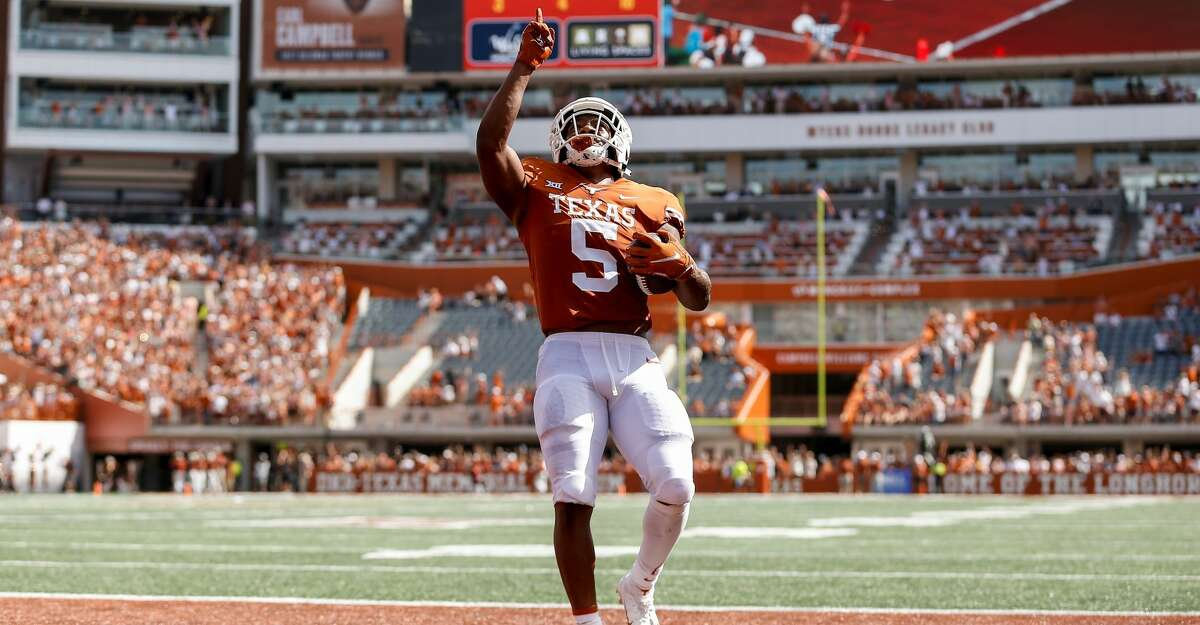 Bijan Robinson #5 of the Texas Longhorns reacts after a touchdown in the first quarter against the Louisiana Ragin' Cajuns at Darrell K Royal-Texas Memorial Stadium on September 04, 2021 in Austin, Texas. (Photo by Tim Warner/Getty Images)
