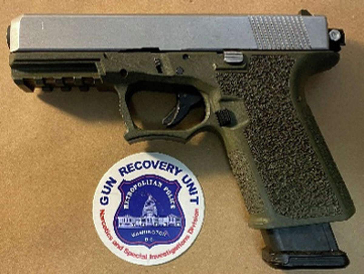 """D.C. Police in June 2021 said they seized this 9mm caliber """"ghost gun"""" during a raid on an apartment on K Street Northeast, near Trinidad. Police said it was equipped with a auto sear enabling it to fire on fully automatic."""