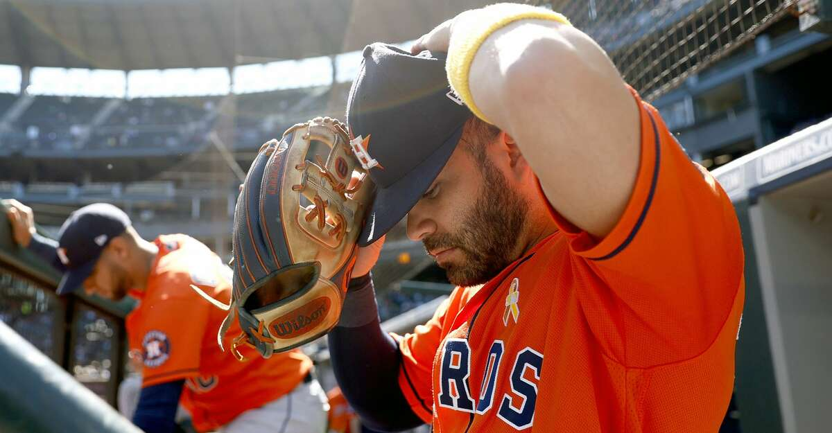 """Jose Altuve #27 of the Houston Astros wears a gold arm band on """"Childhood Cancer Awareness Day"""" during the game against the Seattle Mariners at T-Mobile Park on September 01, 2021 in Seattle, Washington. (Photo by Steph Chambers/Getty Images)"""
