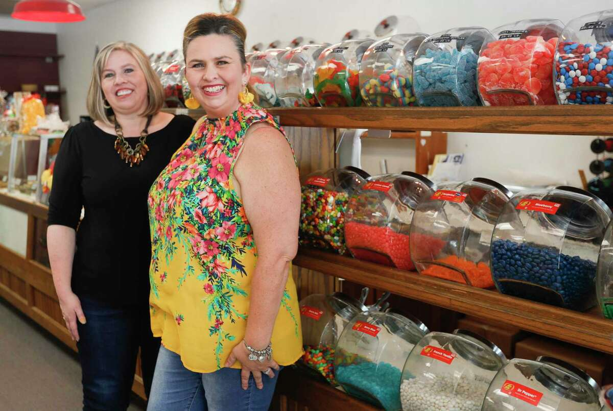 Kristen Graham, right, is seen beside her sister, Courtney Watson, as new co-owners of The Candy House, Saturday, Sept. 4, 2021, in The Woodlands. Graham and Watson are part of a five-person ownership group who recently purchased the local business from long-time owner Don Baker who died in January 2021 after being hospitalized with COIVD-19.
