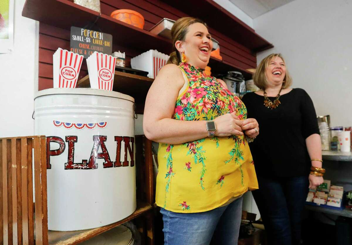 Kristen Graham, left, laughs beside her sister, Reed Watson, as they two talk about their ideas as new co-owners of The Candy House, Saturday, Sept. 4, 2021, in The Woodlands. Graham and Watson are part of a five-person ownership group who recently purchased the local business from long-time owner Don Baker who died in January 2021 after being hospitalized with COIVD-19.