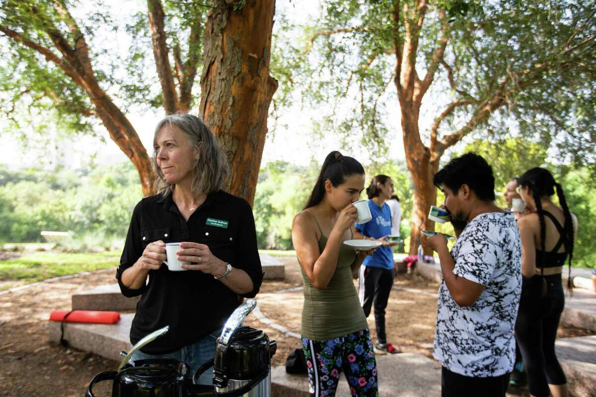 Heather Sullivan, a mindfulness instructor drinks tea after teaching a meditation and mindfulness class as part of Grounding with the Trees at Buffalo Bayou Park, Saturday, Sept. 4, 2021, in Houston. The practice is inspired by Forest Bathing movements in South Korea and Japan.