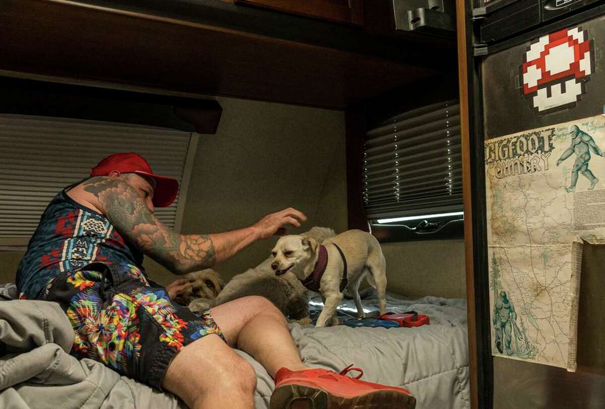 Musician Tommy Ciccone of South Lake Tahoe is camping in his trailer with his dogs at the Truckee evacuation center.