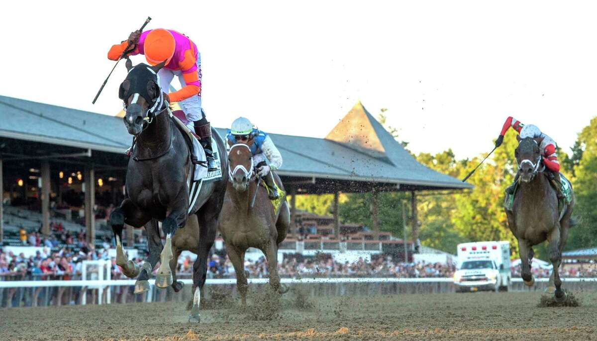 Jockey Ricardo Santana Jr. moves passed Forza Di Oro with Junior Alvarado to win the 123rd running of the Jockey Club Gold Cup at the Saratoga Race Course Saturday Sep, 4, 2021 in Saratoga Springs, N.Y. Special to the Times Union Photo by Skip Dickstein/Tim Lanahan