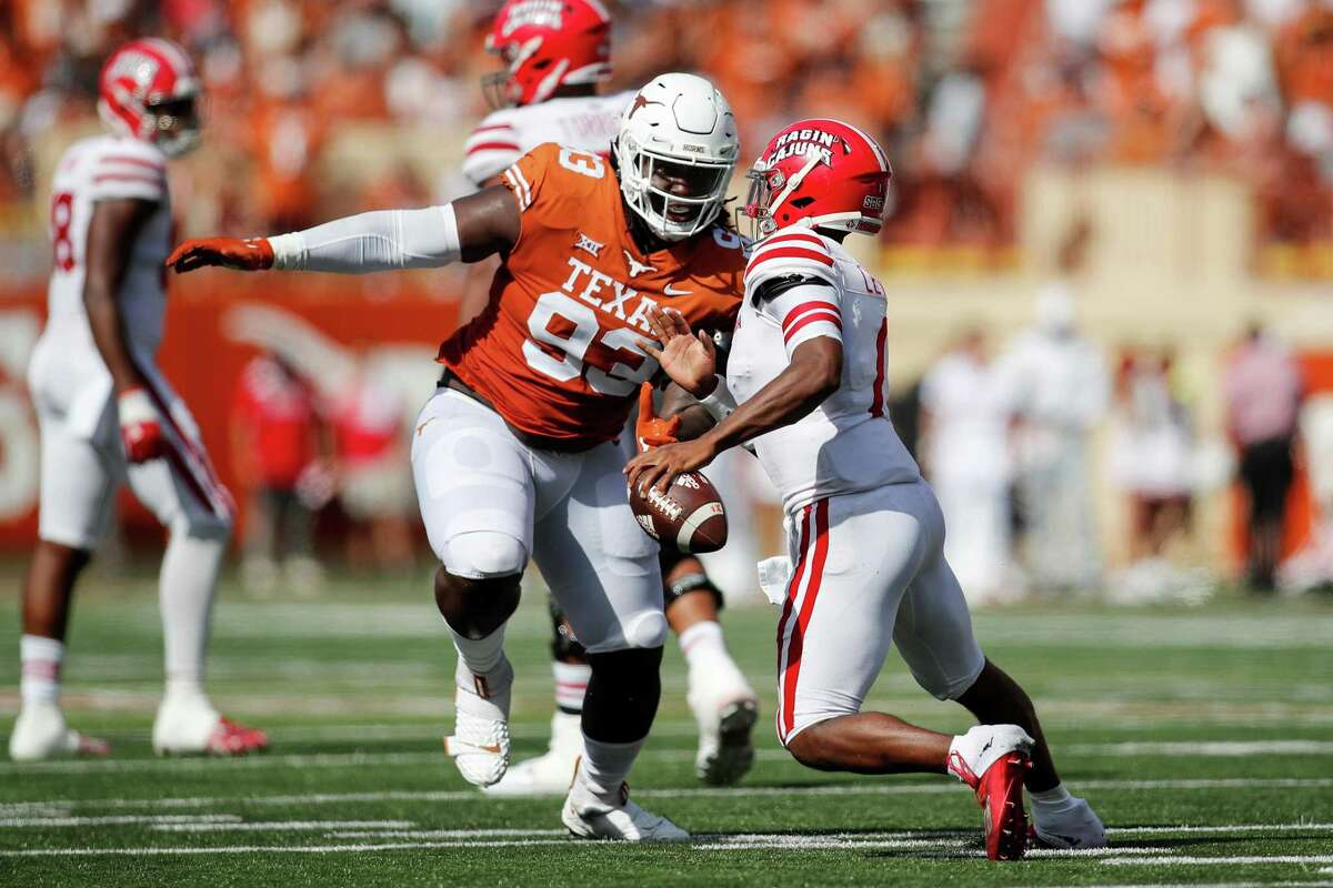 AUSTIN, TEXAS - SEPTEMBER 04: T'Vondre Sweat #93 of the Texas Longhorns pressures Levi Lewis #1 of the Louisiana Ragin' Cajuns in the second quarter during their game at Darrell K Royal-Texas Memorial Stadium on September 04, 2021 in Austin, Texas. (Photo by Tim Warner/Getty Images)