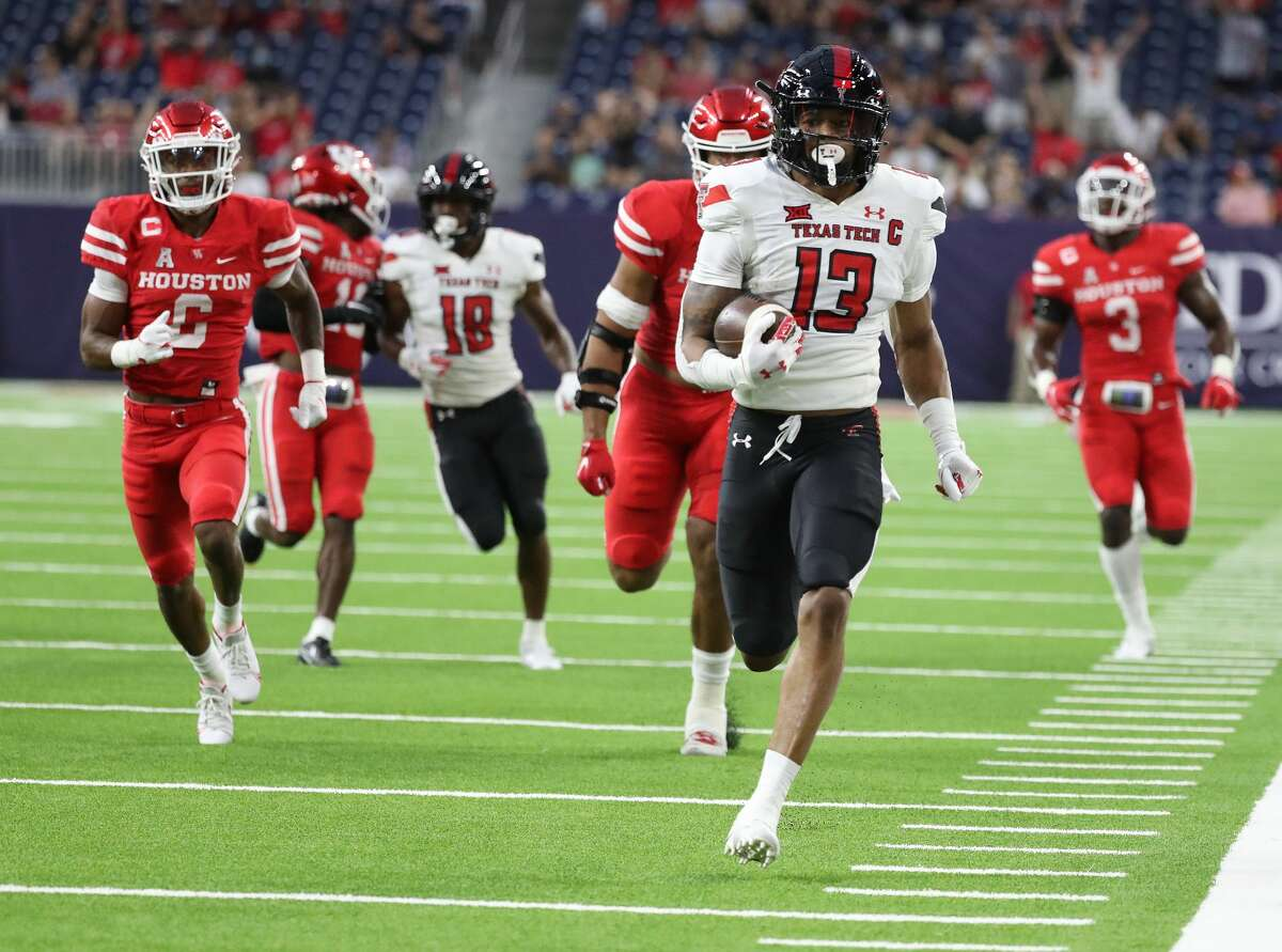 Texas Tech Red Raiders wide receiver Erik Ezukanma (13) gains yardage against Houston Cougars defense during the first quarter of the Texas Kickoff college football game at NRG Stadium, Saturday, September 4, 2021, in Houston.