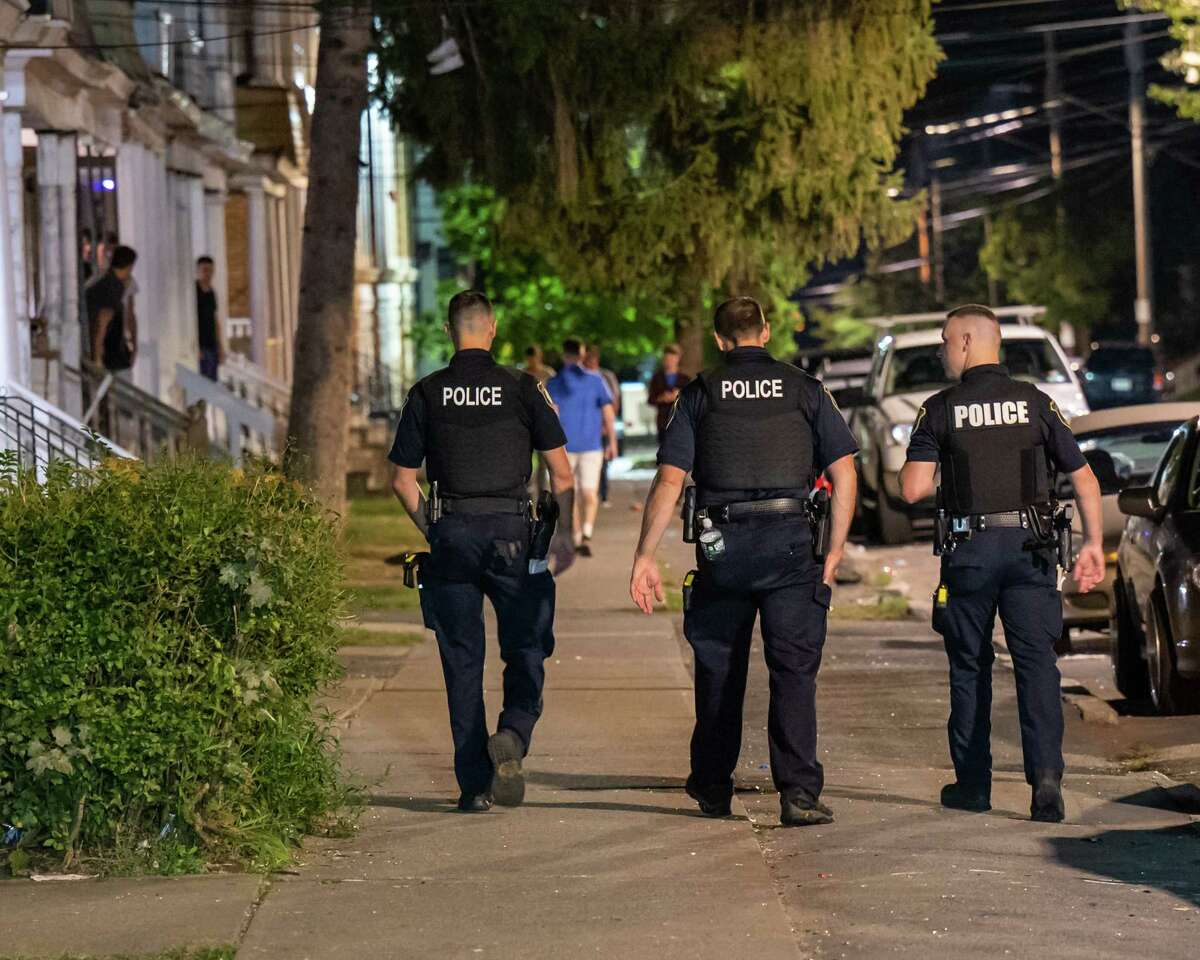 Police officers walk down Hudson Avenue on Friday, Sept. 23, 2021. Patrol of the neighborhood was stepped up after reports surfaced about out of hand college parties (Jim Franco / Special to the Times Union)