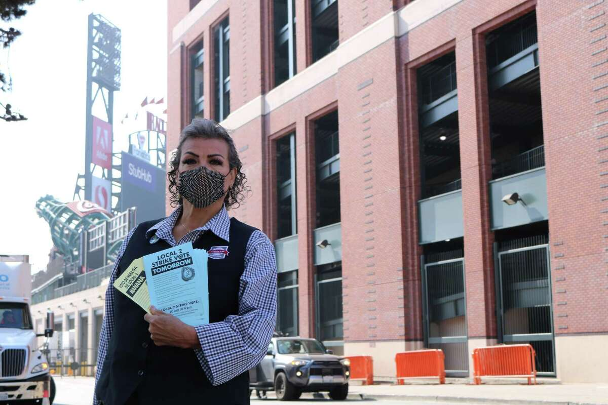 Deborah Torrano, a suite attendant at Oracle Park, poses with her ballot outside of the stadium on Saturday, when 96.7% of food service workers voted in favor to strike in response to concerns over safety during the coronavirus pandemic, health care and hazard pay.