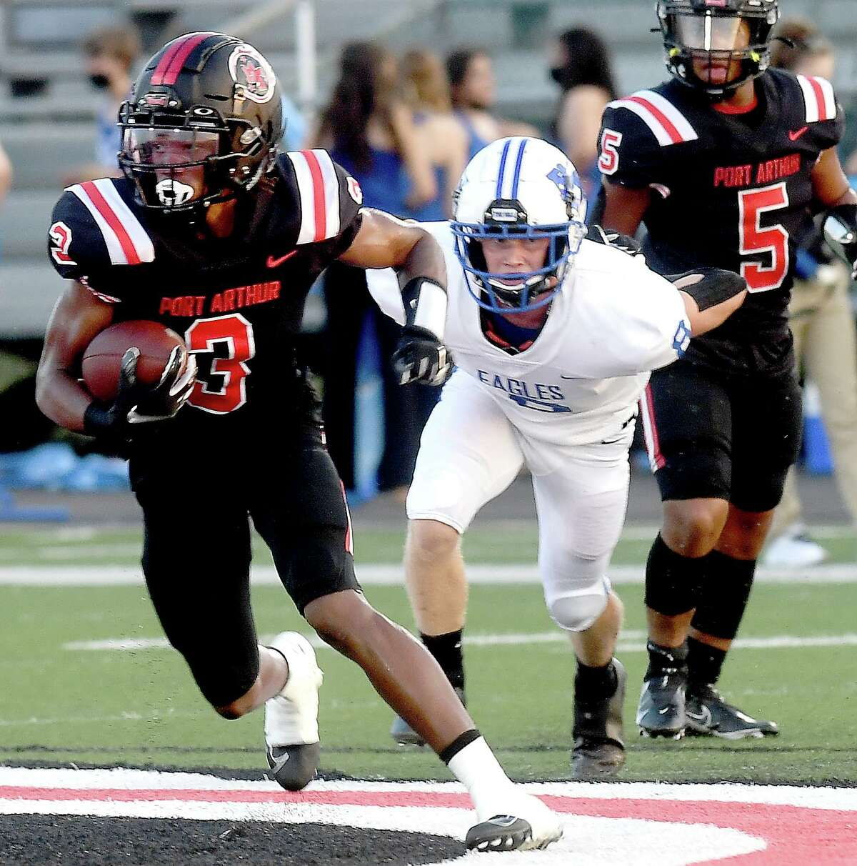 Port Arthur Memorial's Kelby Blanchette evades Barbers Hill's defense during their match-up Friday in Port Arthur. Photo made Friday, September 3, 2021 Kim Brent/The Enterprise