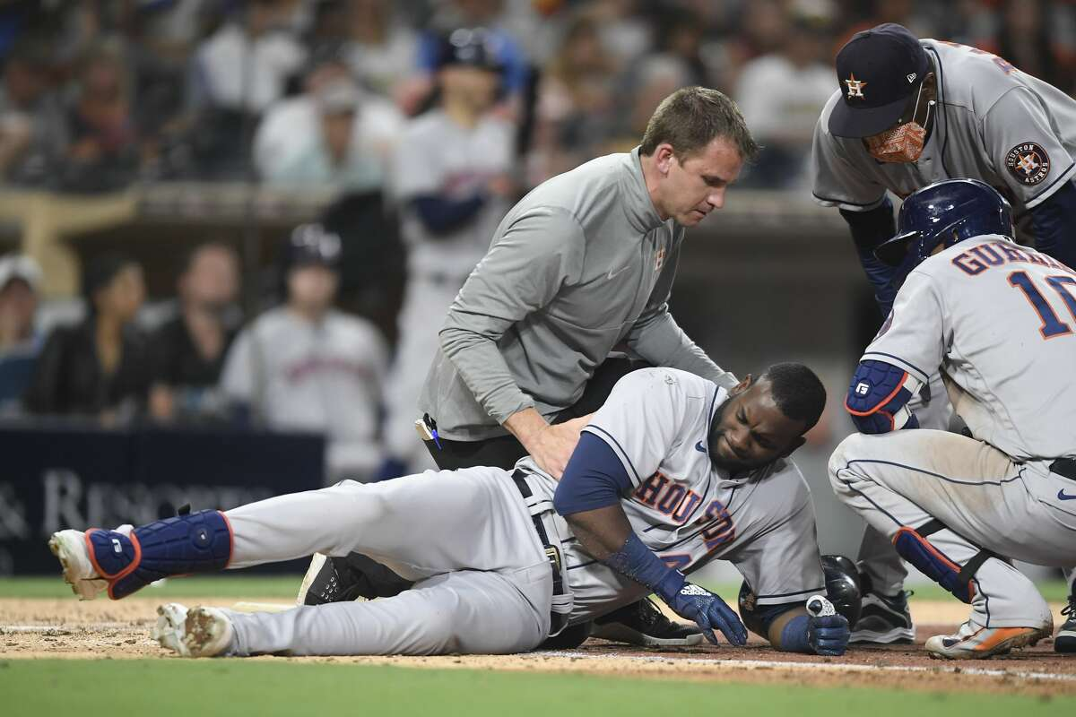 SAN DIEGO, CA - SEPTEMBER 4: Yordan Alvarez #44 of the Houston Astros lies on the ground after being hit with the ball during the fifth inning of a baseball game against the San Diego Padres at Petco Park on September 4, 2021 in San Diego, California. (Photo by Denis Poroy/Getty Images)