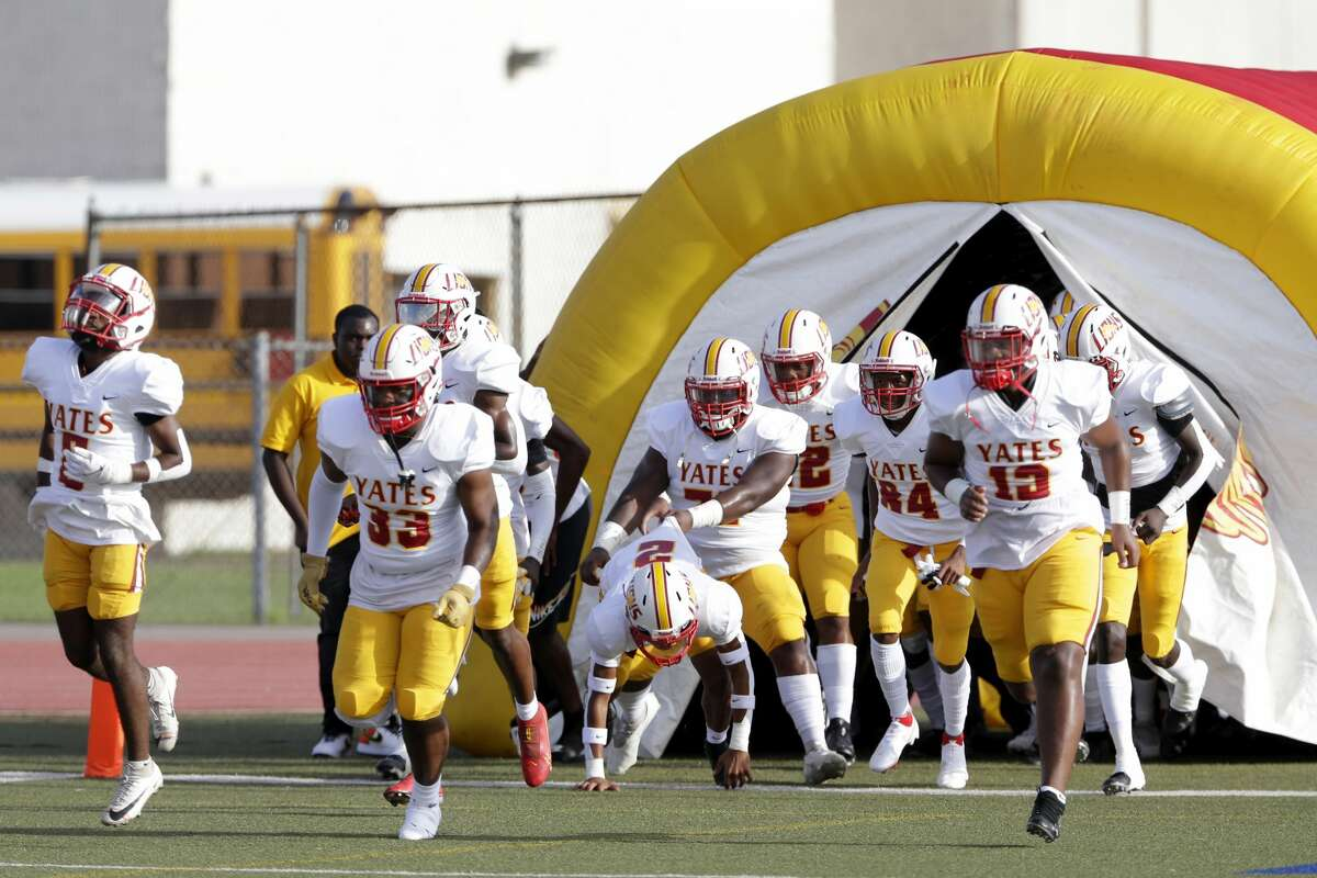 Yates players exit their inflatable tunnel as they take the field before their game against Madison at Butler Stadium Saturday, Sept. 4, 2021 in Houston, TX.