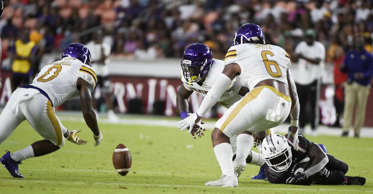 Prairie View A&M defensive back Darius Campbell (0) recovers the fumble of Texas Southern running back Jeff Proctor, bottom right, during the first half of an NCAA college football game, Saturday. Sept. 4, 2021, in Houston.
