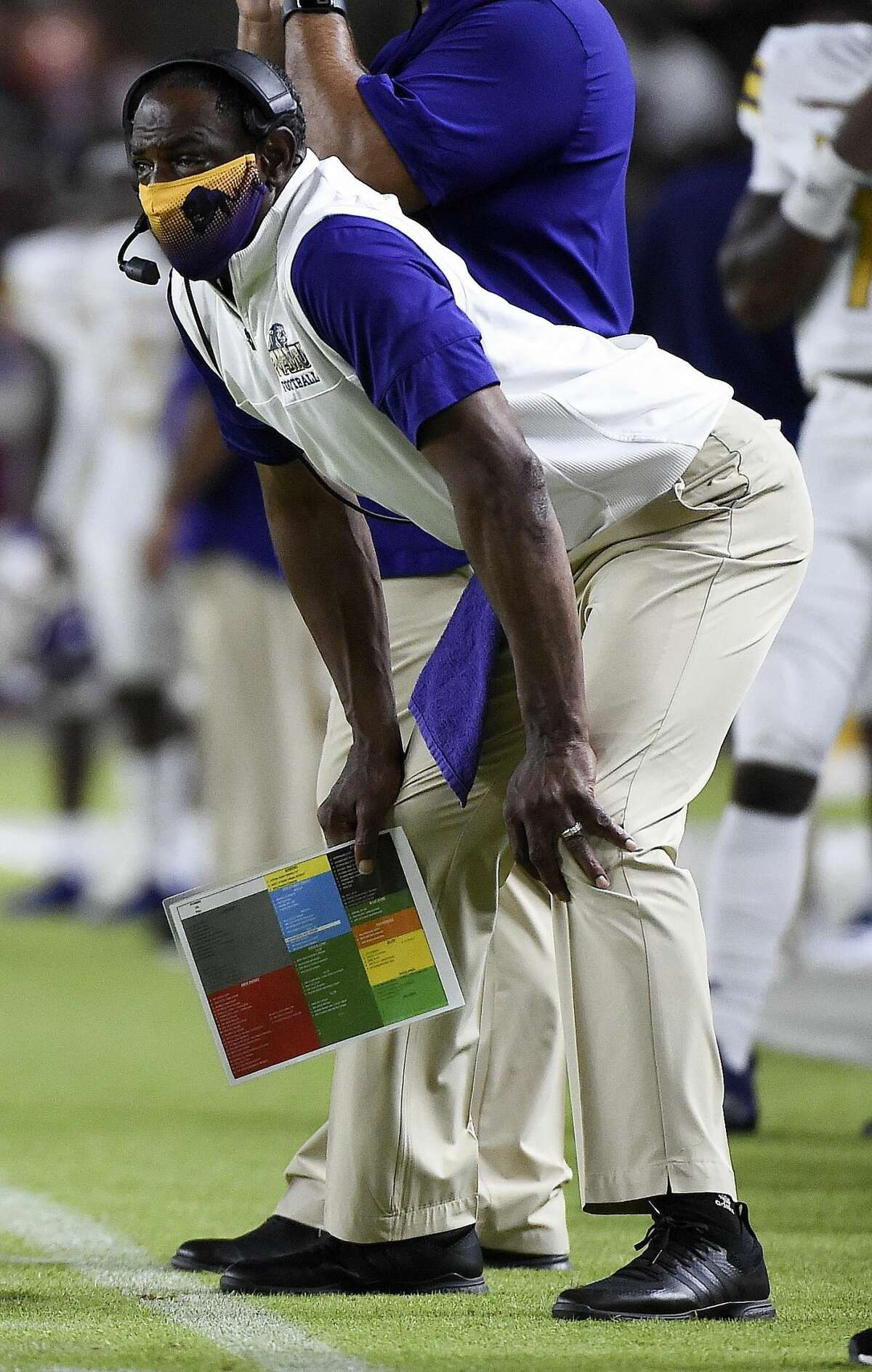 Prairie View A&M head coach Eric Dooley watches from the sidelines during the first half of an NCAA college football game against Texas Southern , Saturday. Sept. 4, 2021, in Houston.