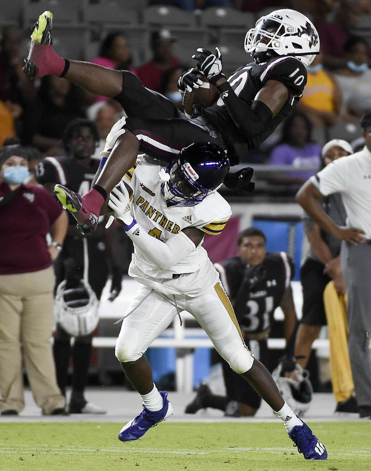 Texas Southern wide receiver Ke'Lenn Davis is tackled by Prairie View A&M defensive back Xavier Johnson after catching a pass during the second half of an NCAA college football game, Saturday. Sept. 4, 2021, in Houston.