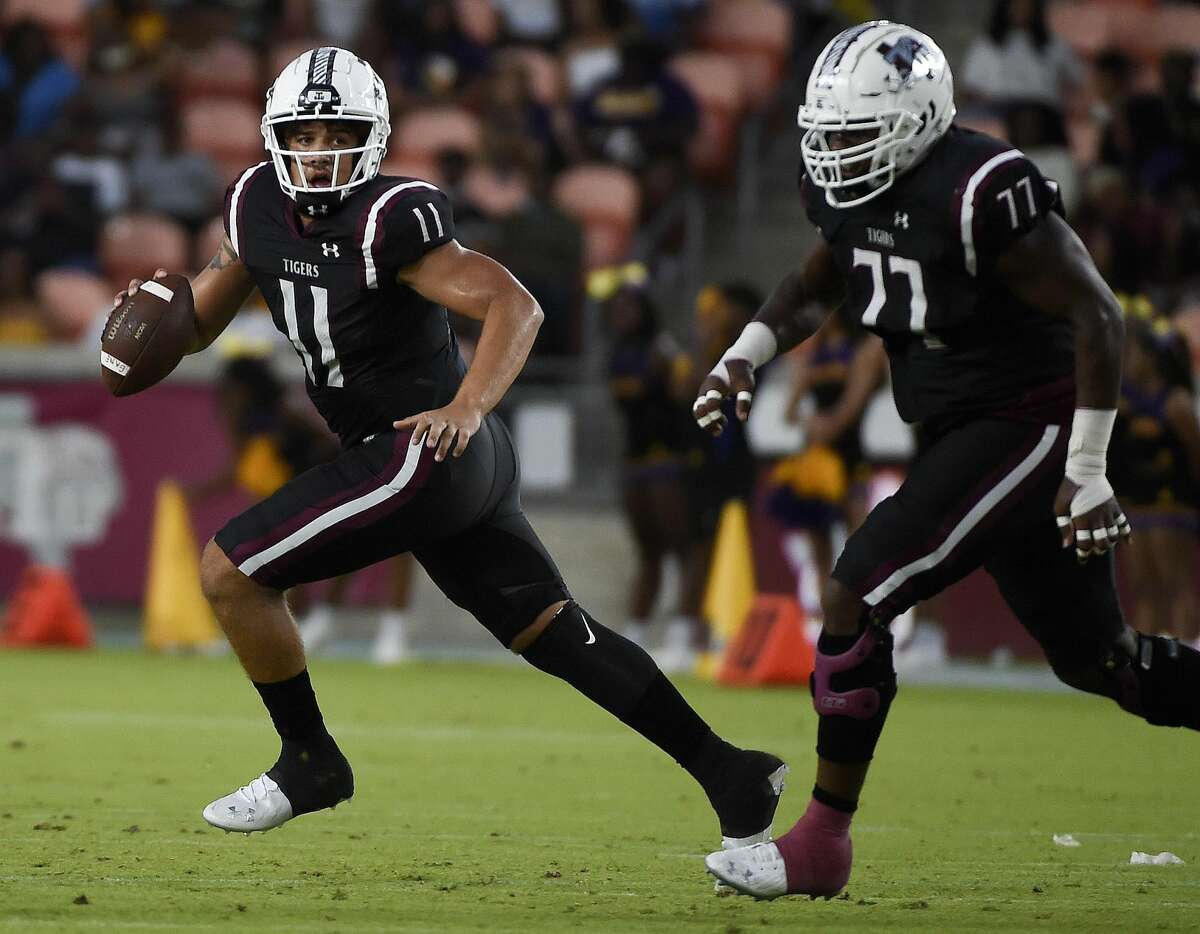 Texas Southern quarterback Jalen Brown (11) scrambles during the first half of an NCAA college football game against Prairie View A&M, Saturday. Sept. 4, 2021, in Houston.