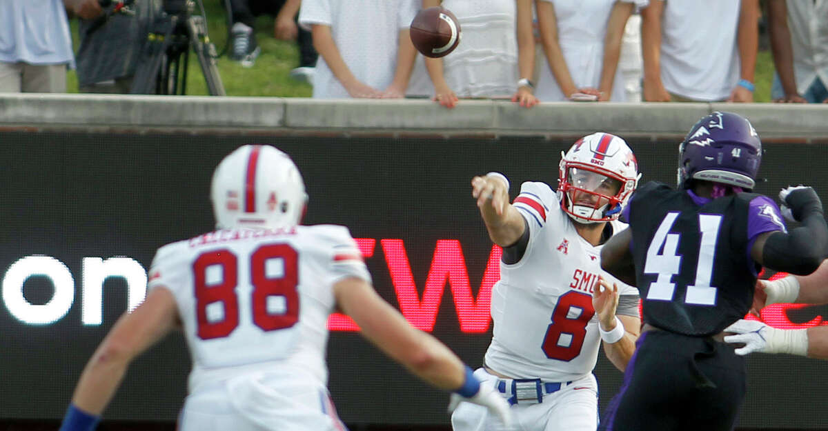 SMU quarterback Tanner Mordecai (8) throws a pass to tight end Grant Calcaterra (88) as Abilene Christian defensive lineman Tyrin Bradley (41) closes in during during the first quarter of an NCAA college football game Saturday, Sept. 4, 2021, in Dallas. (Steve Hamm/The Dallas Morning News via AP)