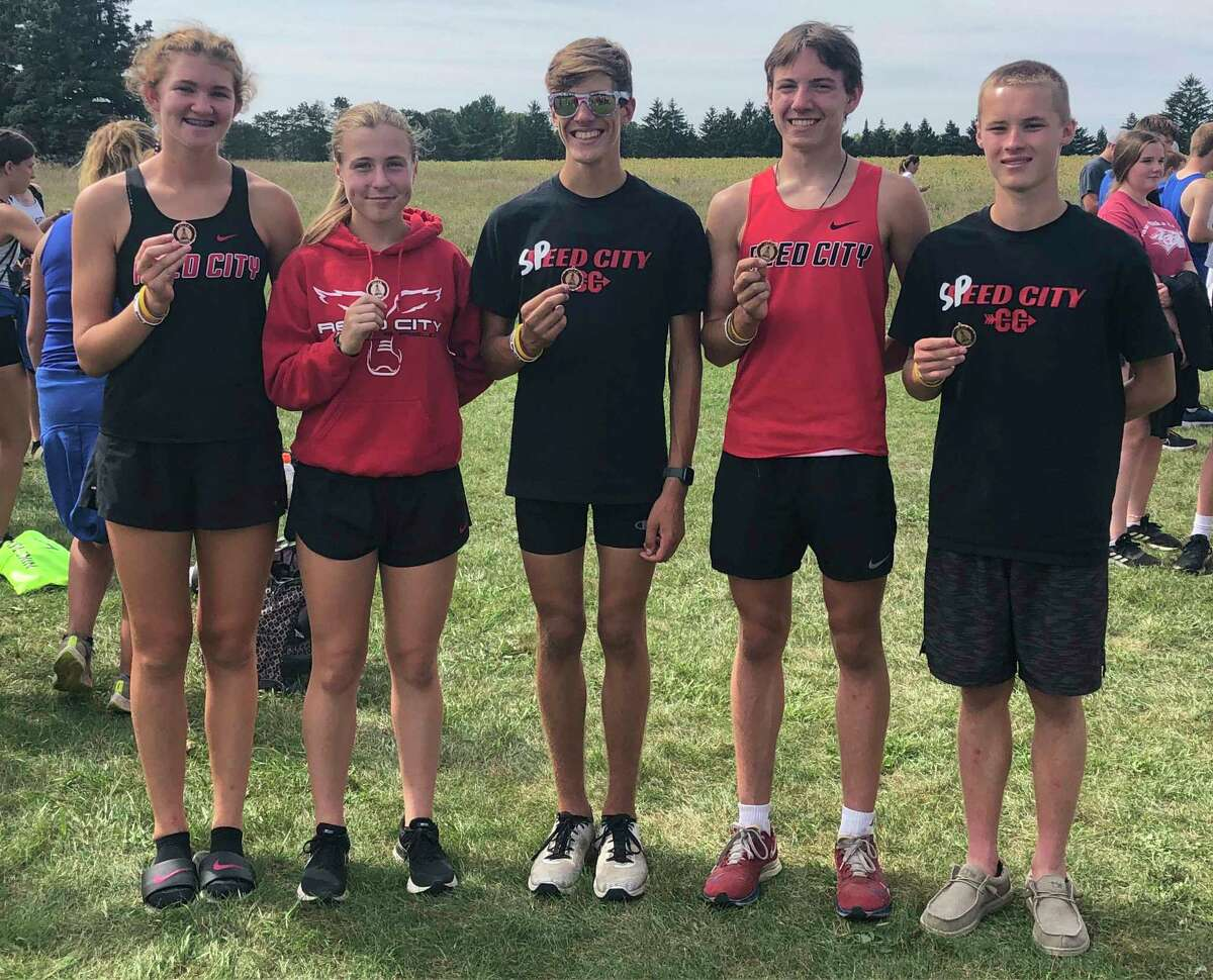From left, Reed City's Nora Smoes, Carly Carlson, Gus Rohde, Anthony Kiaunis, and Ryan Allen celebrate their medal winning runs at the Oiler Invite on Friday. (Courtesy photo).