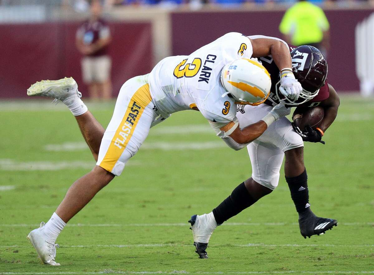 COLLEGE STATION, TEXAS - SEPTEMBER 04: Ainias Smith #0 of the Texas A&M Aggies is tackled by Dean Clark #3 of the Kent State Golden Flashes at Kyle Field on September 04, 2021 in College Station, Texas. (Photo by Bob Levey/Getty Images)