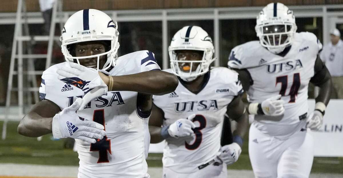 UTSA's Zakhari Franklin, left, celebrates his touchdown reception during the second half of an NCAA college football game against Illinois, Saturday, Sept. 4, 2021, in Champaign, Ill. (AP Photo/Charles Rex Arbogast)