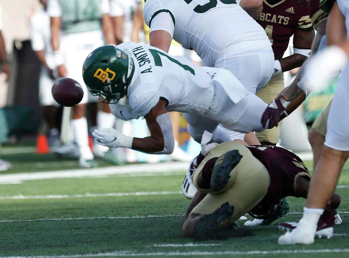 Baylor Abram Smith(7) fumbles after taking a hit. Baylor defeated Texas State 29-21 on Saturday, Sept. 4, 2021.