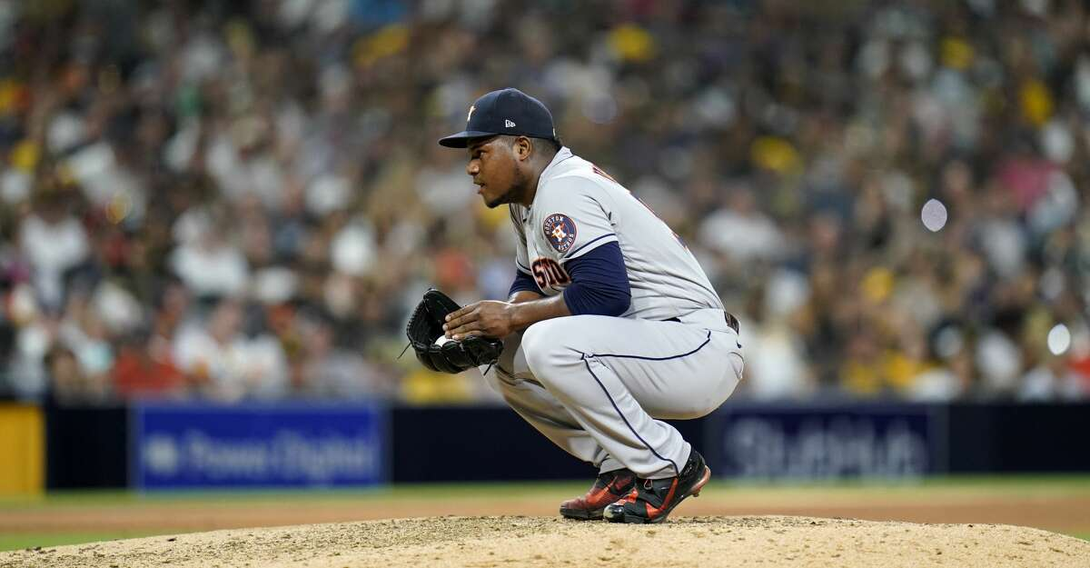 Houston Astros starting pitcher Framber Valdez pauses as he works against a San Diego Padres batter during the sixth inning of a baseball game Saturday, Sept. 4, 2021, in San Diego. (AP Photo/Gregory Bull)
