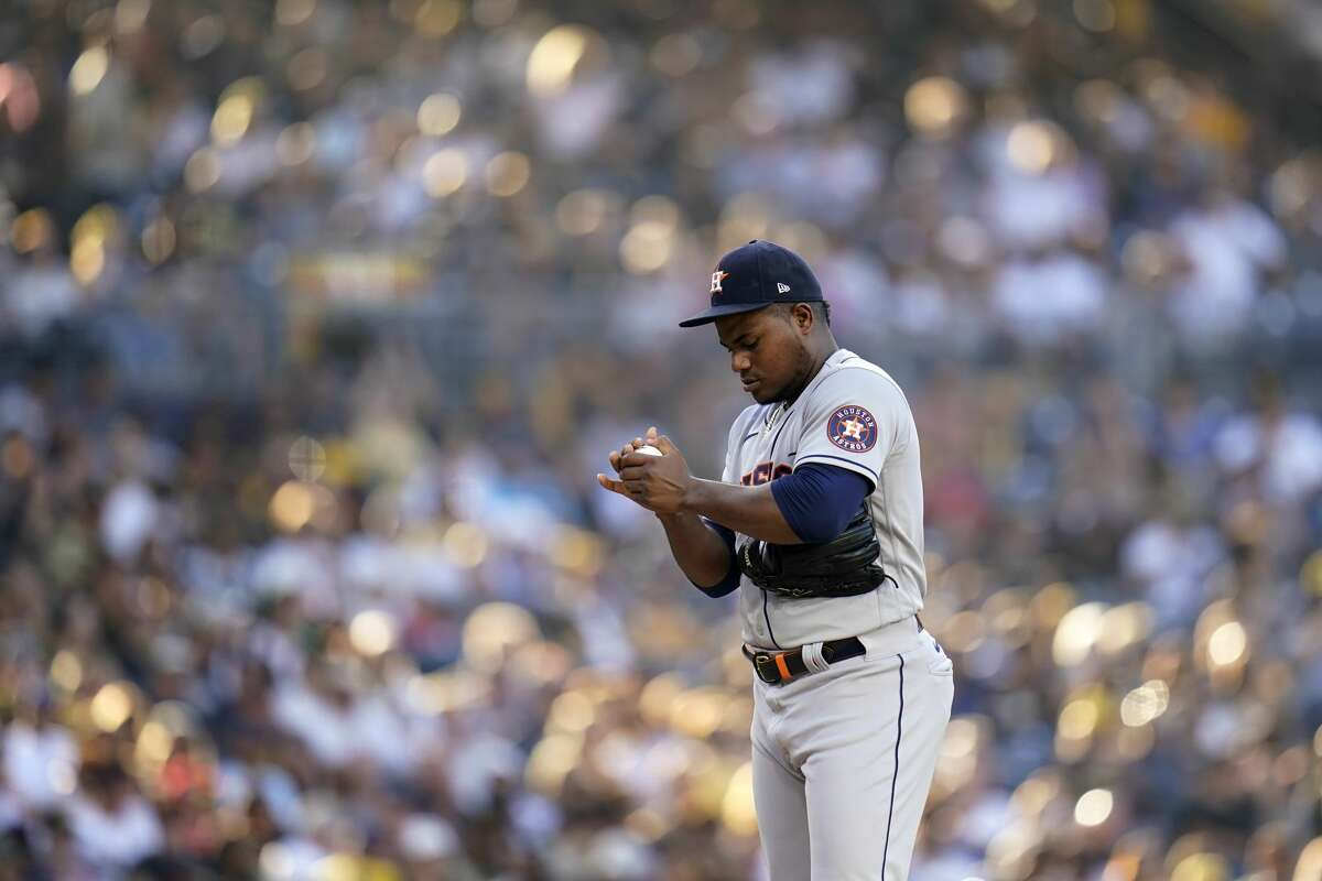 Houston Astros starting pitcher Framber Valdez pauses as he works against a San Diego Padres batter during the first inning of a baseball game Saturday, Sept. 4, 2021, in San Diego. (AP Photo/Gregory Bull)