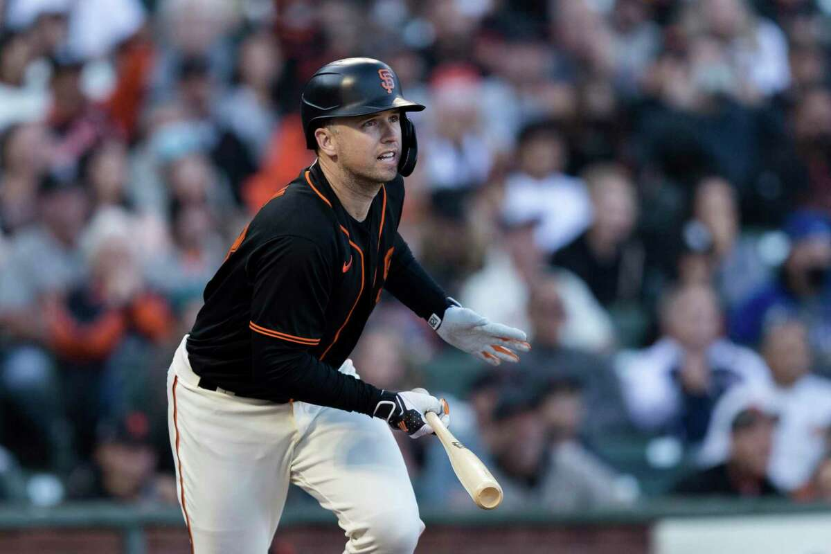 San Francisco Giants' Buster Posey hits an RBI double against the Los Angeles Dodgers in the first inning of a baseball game in San Francisco, Saturday, Sept. 4, 2021. (AP Photo/John Hefti)