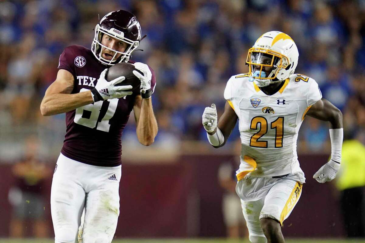Texas A&M wide receiver Caleb Chapman (81) catches a pass as Kent State cornerback Montre Miller (21) defends during the during the second half of an NCAA college football game on Saturday, Sept. 4, 2021, in College Station, Texas. (AP Photo/Sam Craft)