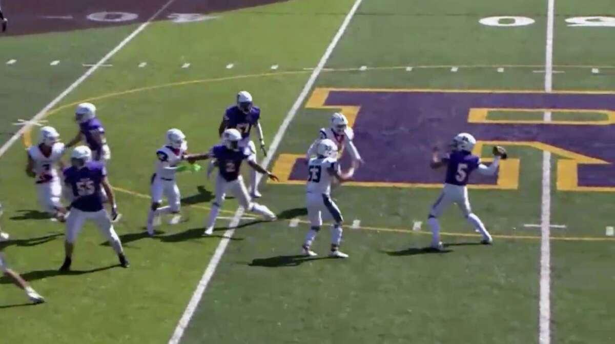 Riordan QB Michael Gormley throws a pass that resulted in a 42-yard touchdown strike to Zachary Jones.