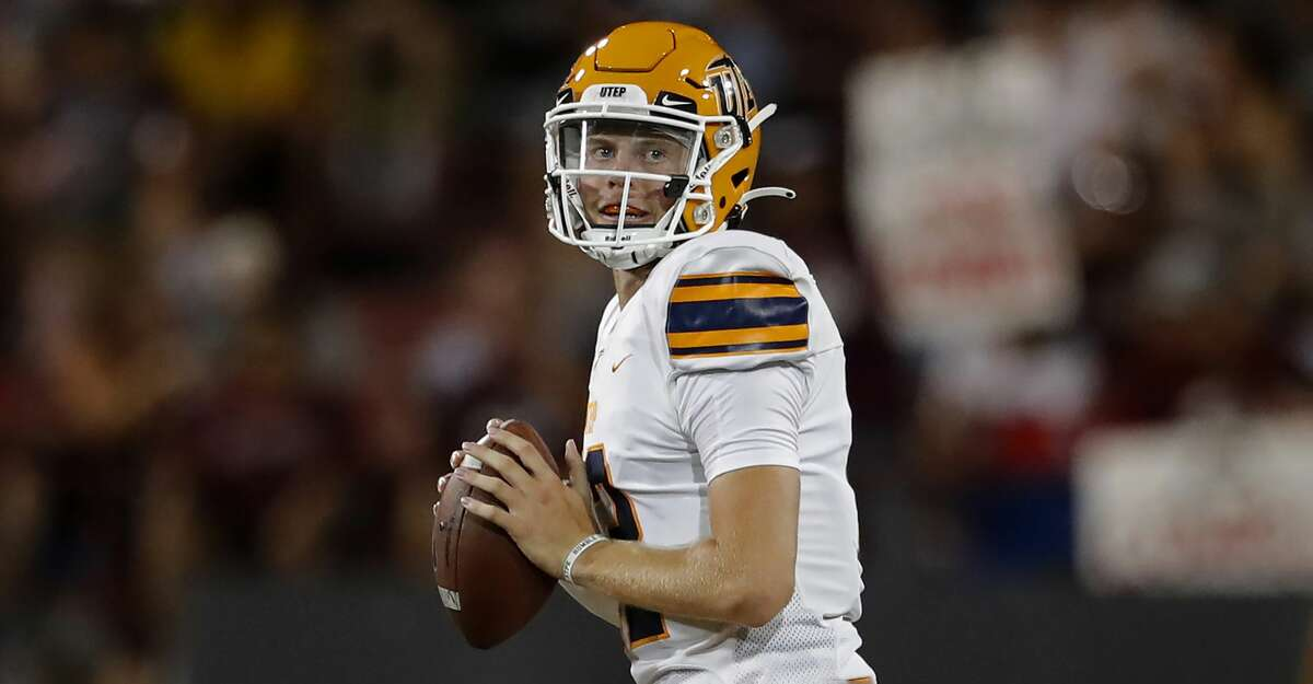 UTEP quarterback Gavin Hardison searches for a receiver during an NCAA football game against New Mexico State on Saturday, Aug. 28, 2021, in Las Cruces, N.M. (AP Photo/Andres Leighton)