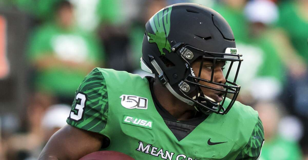 North Texas running back DeAndre Torrey (13) carries the ball back to the line of scrimmage during the second half of college football game Saturday, Nov 23, 2019, in Houston.