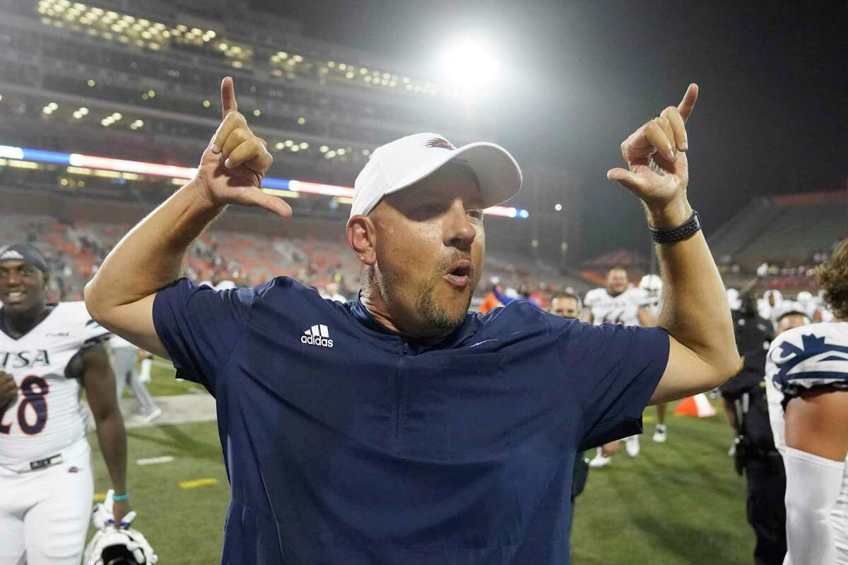 UTSA head coach Jeff Taylor celebrates his team's win over Illinois in an NCAA college football game Saturday, Sept. 4, 2021, in Champaign, Ill. (AP Photo/Charles Rex Arbogast)