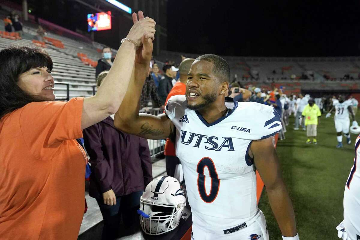 UTSA quarterback Frank Harris celebrates his team's win over Illinois in an NCAA college football game Saturday, Sept. 4, 2021, in Champaign, Ill. (AP Photo/Charles Rex Arbogast)