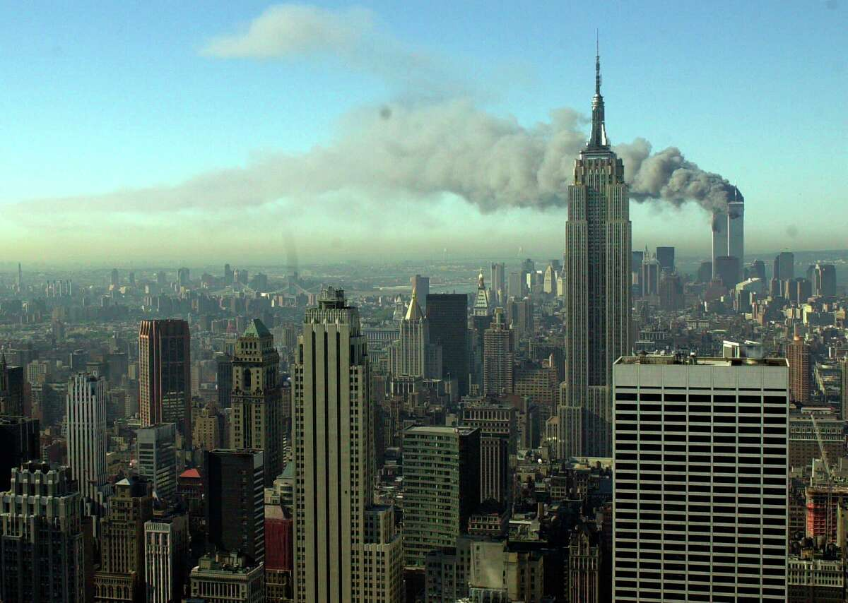 Smoke billows across the New York City skyline after two hijacked planes crashed into the twin towers on Sept. 11, 2001.