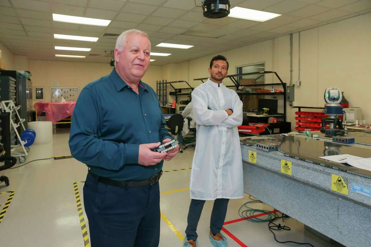 Kam Ghaffarian, co-founder of several Houston-based companies describes one of the current projects (production lead manager Arnab Roy in background) on August 11, 2021 at the Intuitive Machines facility in Houston, TX.