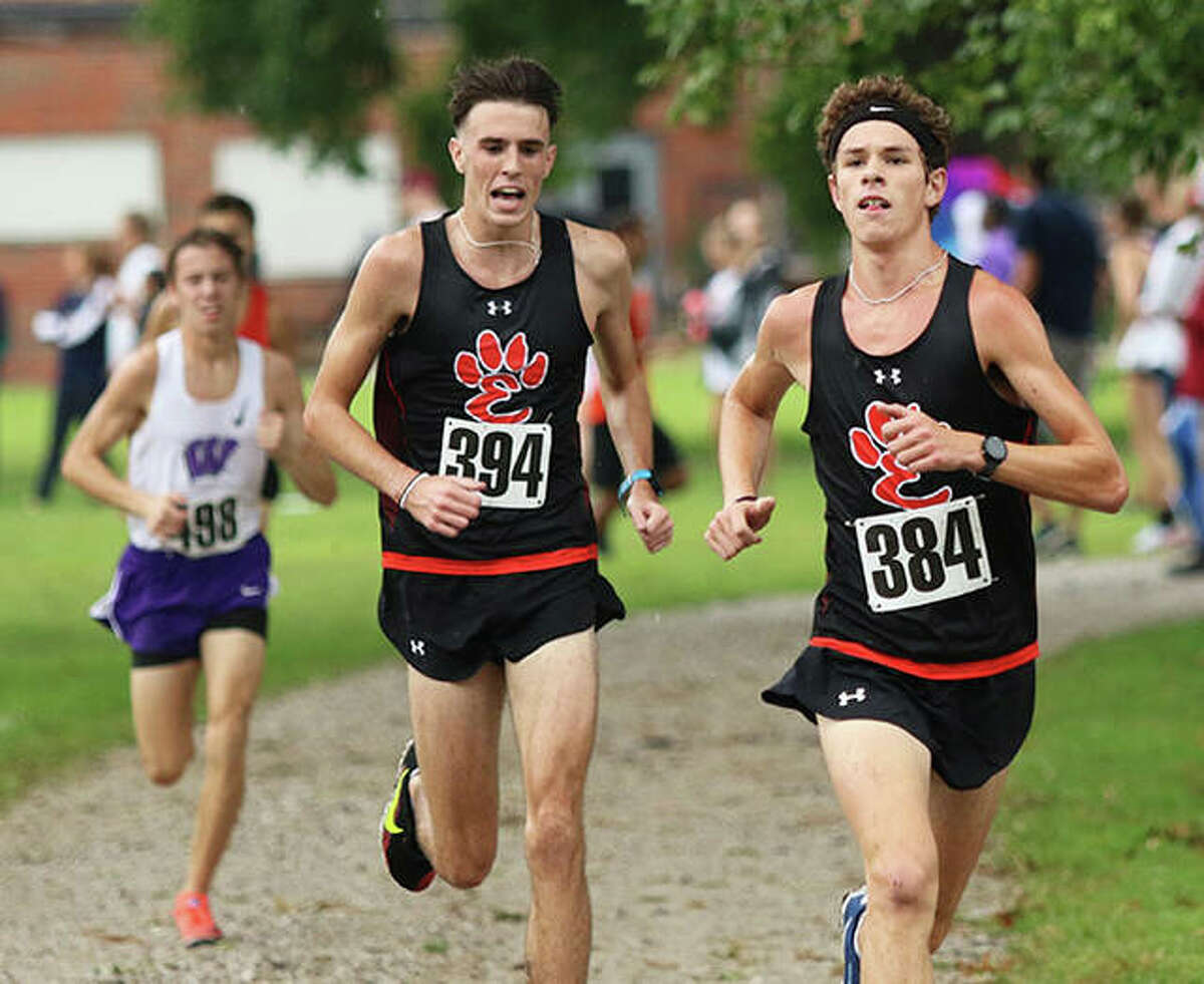 Edwardsville's Ryan Watts (394) shouts out encouragement to teammate Geordan Patrylak (384) in the final quarter-mile at Saturday's Granite City Invite at Wilson Park. Patrylak ran fifth, with Watts in sixth, one-half second apart at the finish.