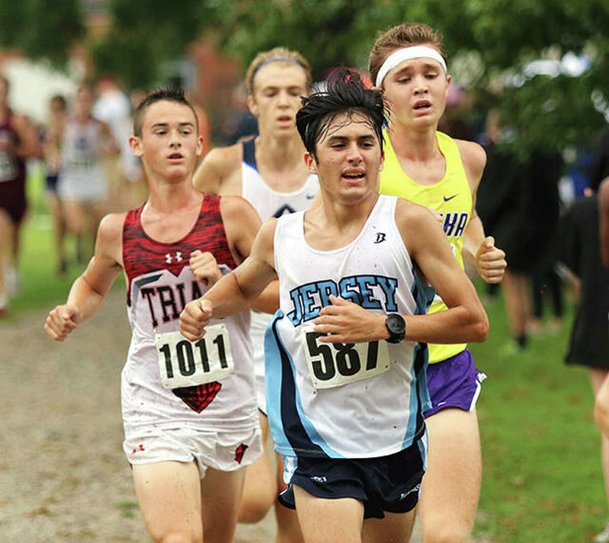 Jersey senior Cole Martinez (front) leads Triad sophomore Andrew Pace (1011) and Eureka senior Jake Brueggemann in the final 400 meters at Saturday morning's Granite City Invite at Wilson Park. Martinez ran 16th in the race, with Pace in 14th and Brueggemann in 17th.