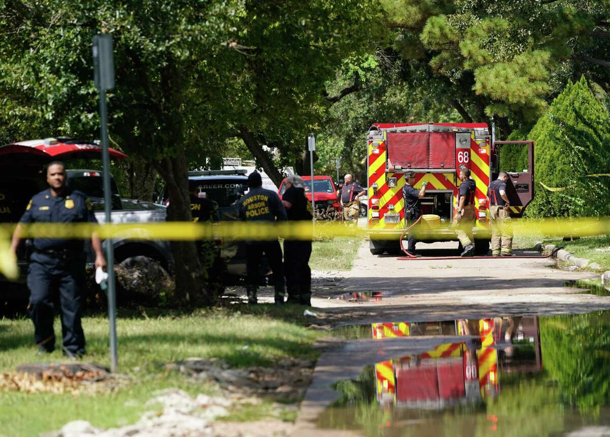 Emergency personnel are shown at the scene where four people with gunshot wounds were found dead at the scene of a house fire in the 7500 block of Imogene Street Sunday, Sept. 5, 2021 in Houston.