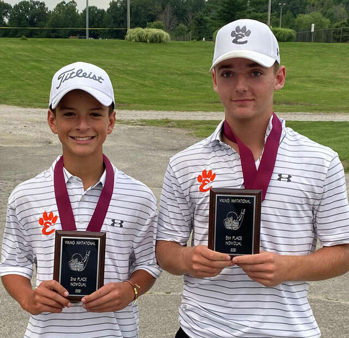 Edwardsville's Ryan Suhre, left, and Joe Chiarodo display their plaques from the Danville Invitational on Friday in Danville.