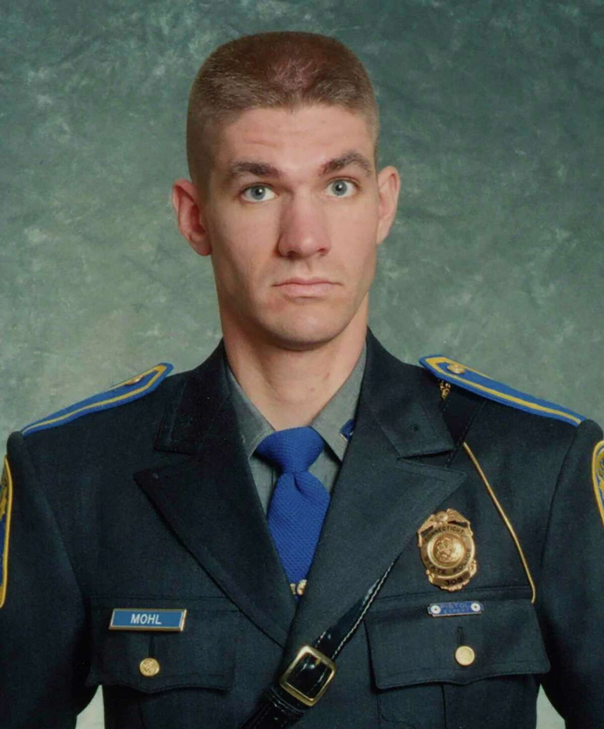 This undated photo provided by the Connecticut State Police shows Sgt. Brian Mohl, a 26-year veteran of their Woodbury department. Mohl called for help about 3:30 a.m. Thursday, Sept. 2, 2021. His cruiser had been swept away. Police searched the area with divers, helicopters, boats and drones. After daybreak, they found his body in the swollen river after the remnants of Hurricane Ida pummeled the Northeast with record-breaking rain that flooded roads and houses, killing dozens. (Connecticut State Police via AP)